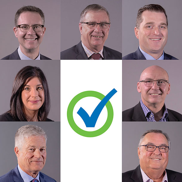 This is an image comprised of 7 headshot photos of the candidates for Servus's board of directors in 2019. In the middle, there is a vote symbol of a green Servus circle and a blue check mark.