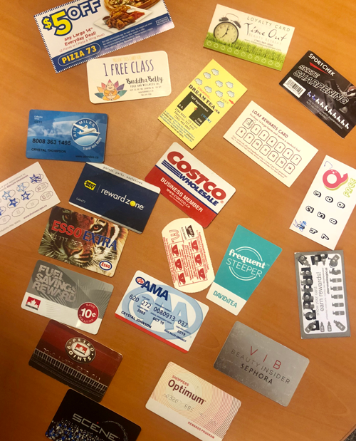 Multiple different coupons and cards for club members.